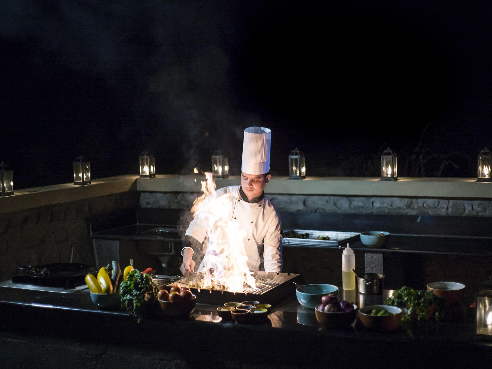 Chef cooking foods out door  at Meghauli Serai