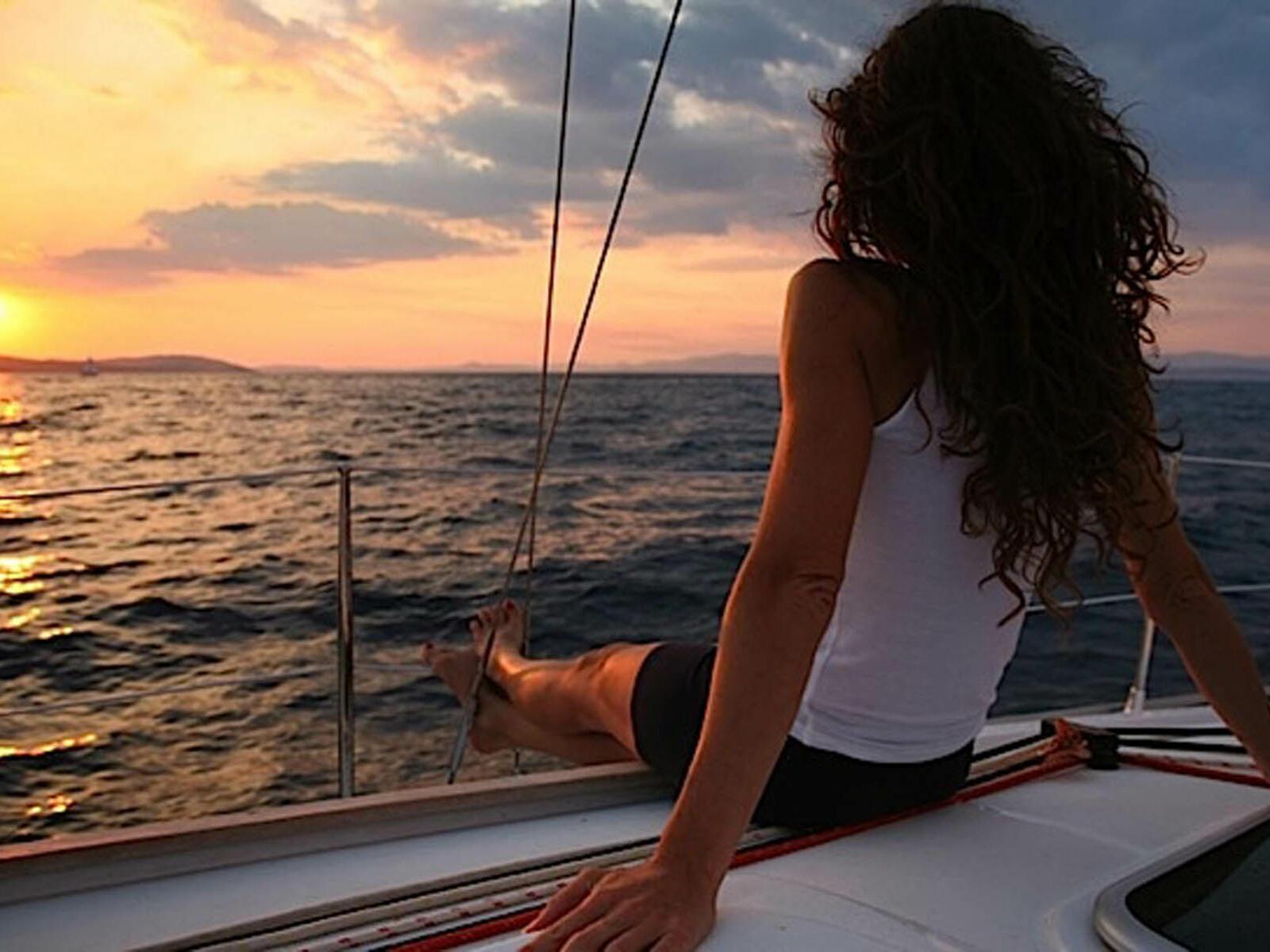 A girl relaxing on a boat near Hotel Cascais Miragem