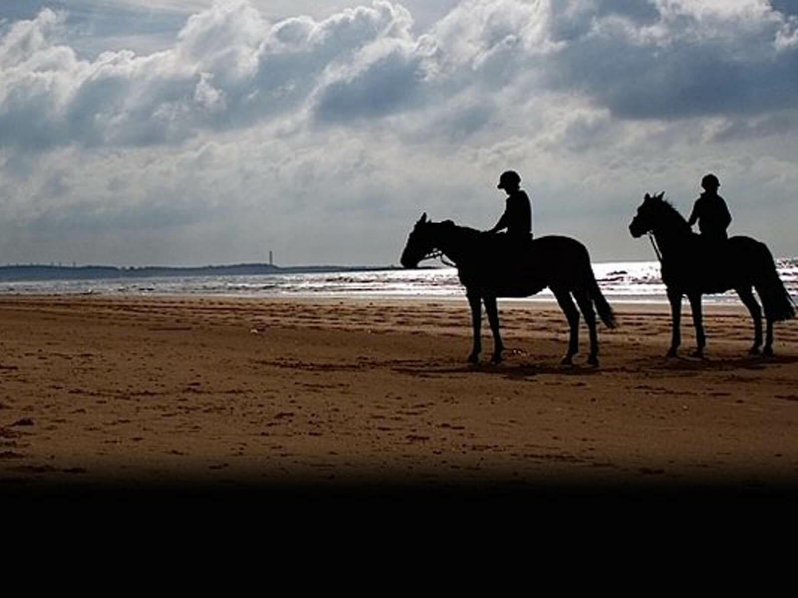 Two men on horses at the sea shore near Hotel Cascais Miragem