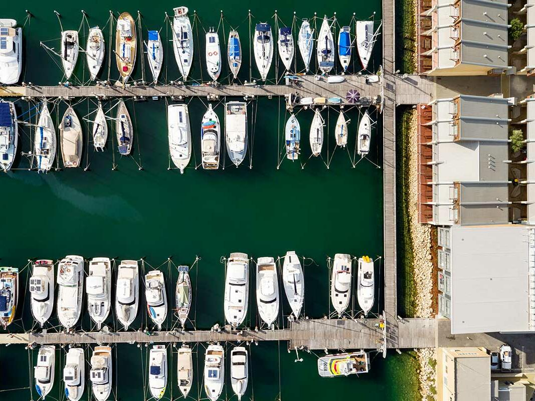 Aerial view of the boats docked by the pier near Be Fremantle