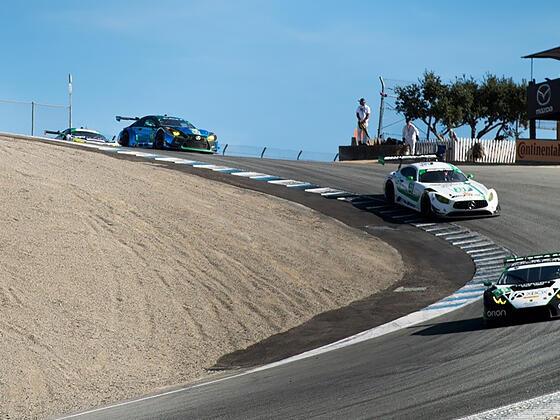 Cars racing at Mazda Raceway Laguna Seca near Tally Ho Inn