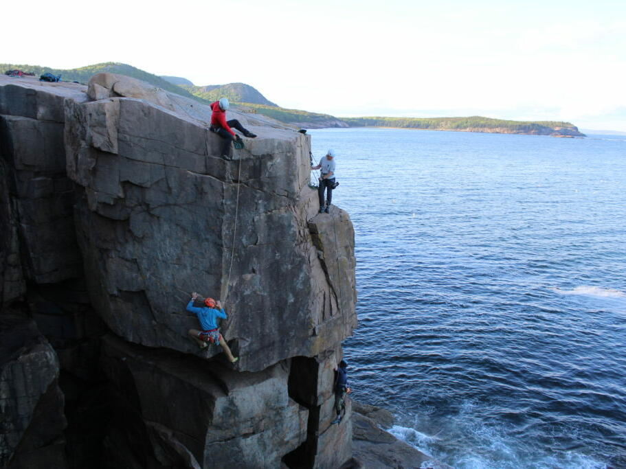 group of people rock climbing