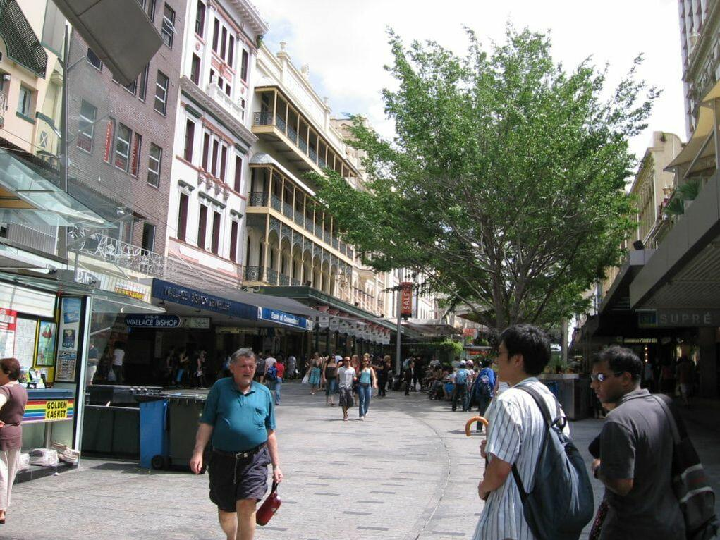 People walking on Queen street mall near George Williams Hotel