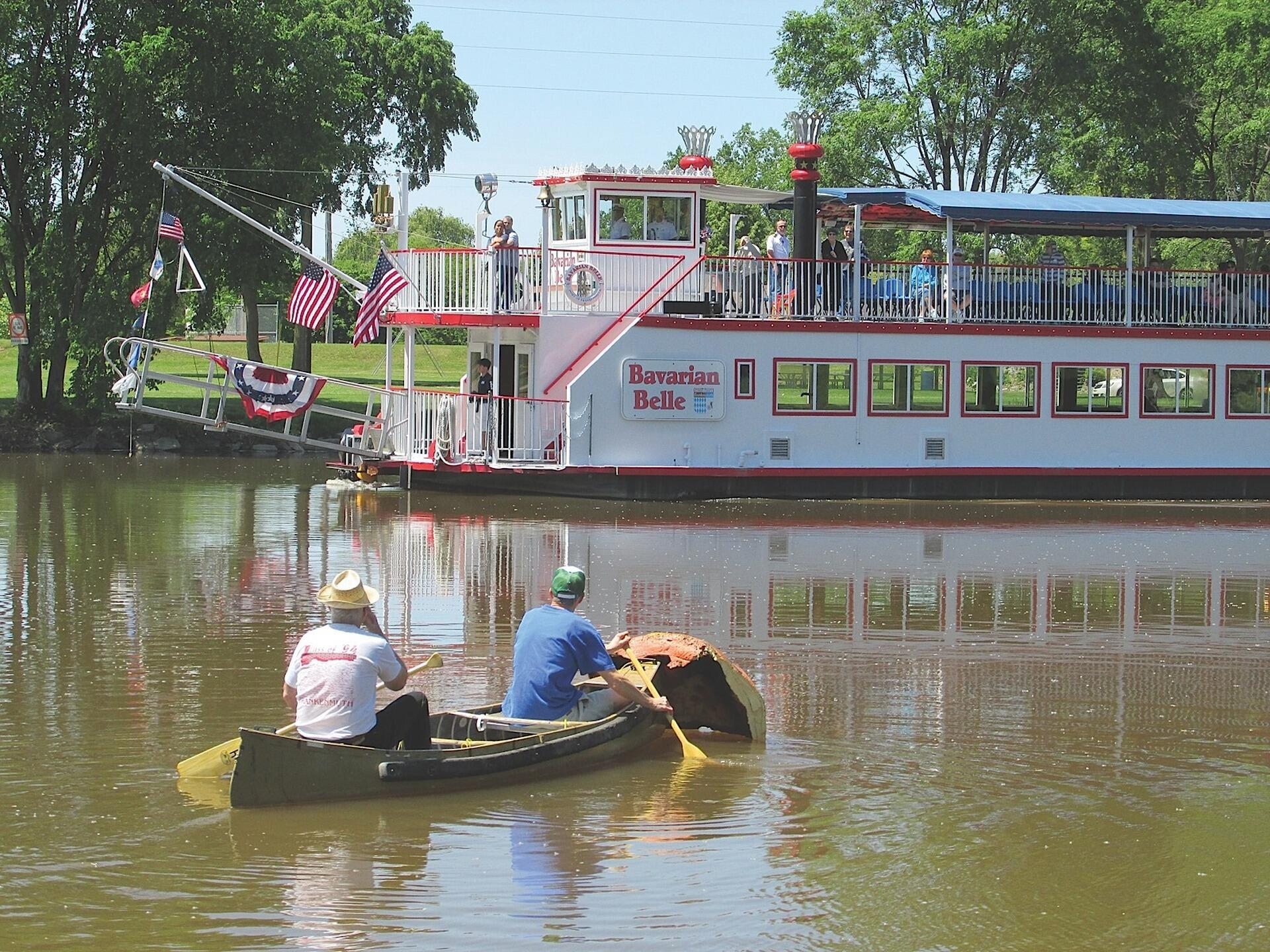 2 people riding a boat at Bavarian Belle Riverboat Tours