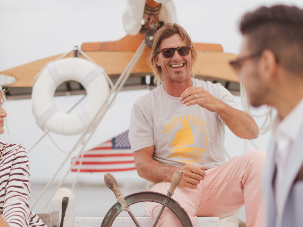 Man laughing from a yacht ship near The Rockaway Hotel