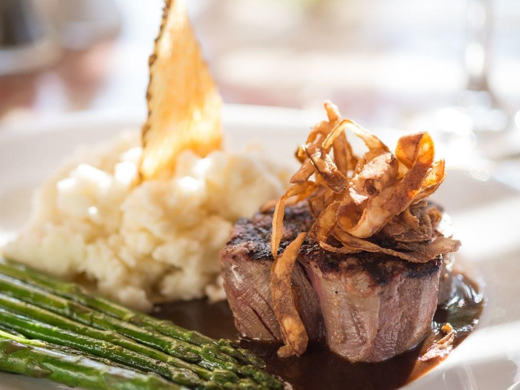Meat entree with mashed potatoes and asparagus