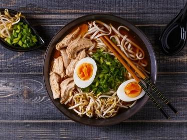 bowl with noodles, eggs and broth