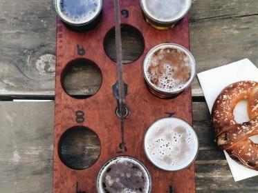 pretzel and flight of beers