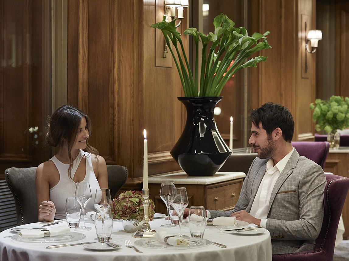couple dining at the Parliament restaurant at NJV Athens Plaza hotel