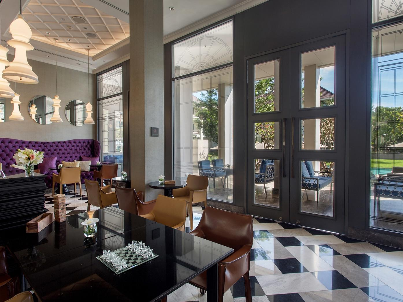 The Library with comfortables seating at U Hotels and Resorts