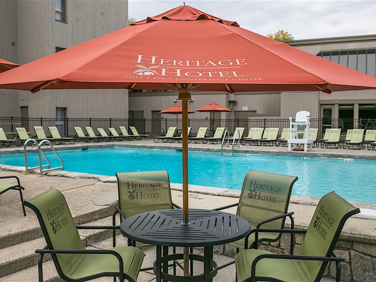 Outdoor pool seating with umbrella