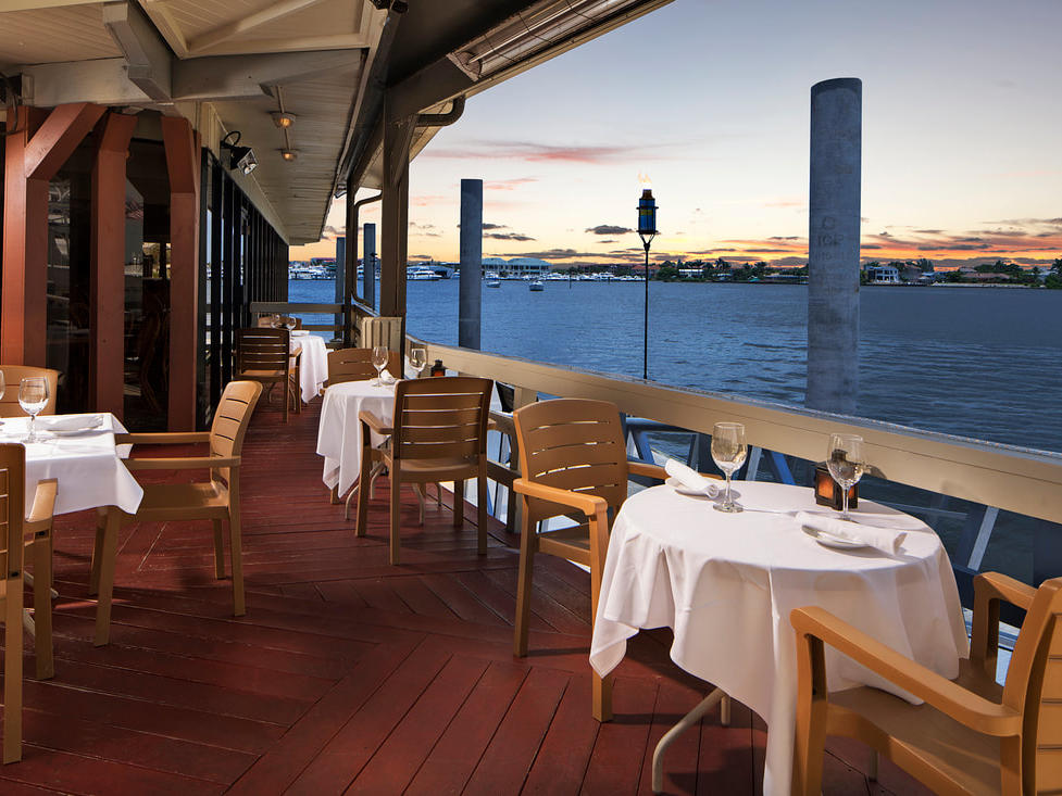 Outdoor restaurant seating with harbor views.