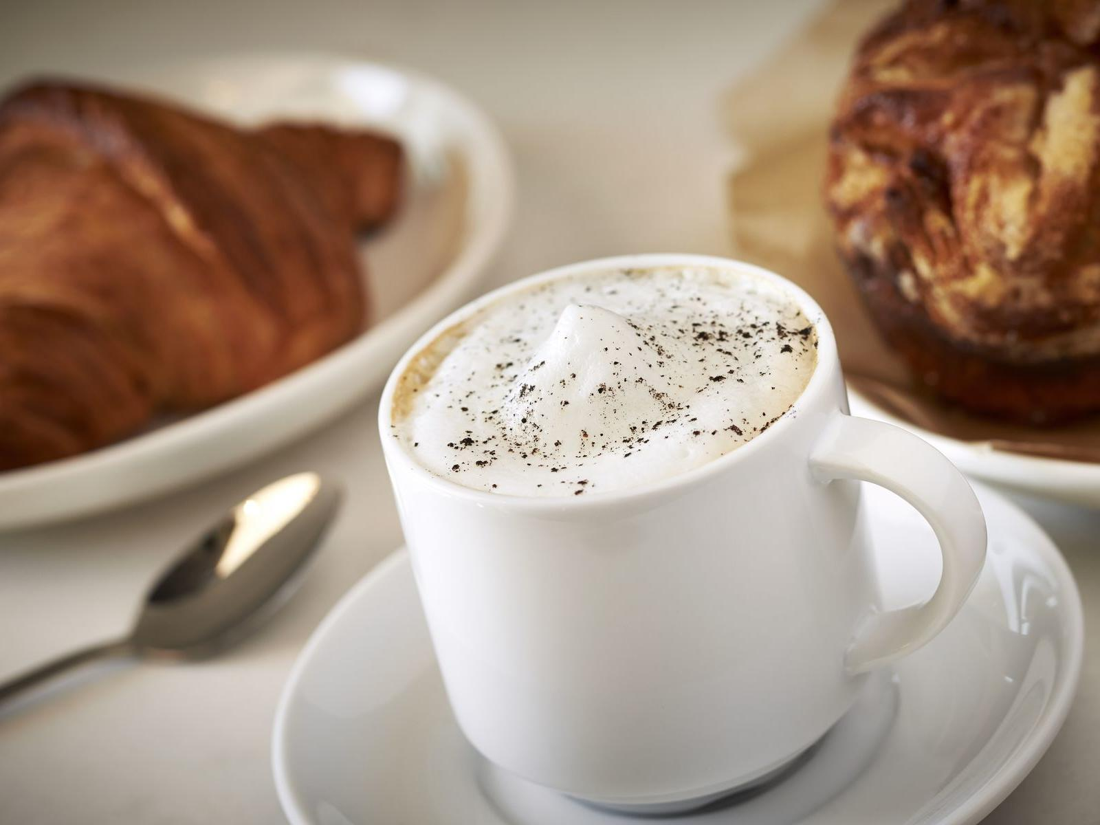 Latte and breakfast pastries