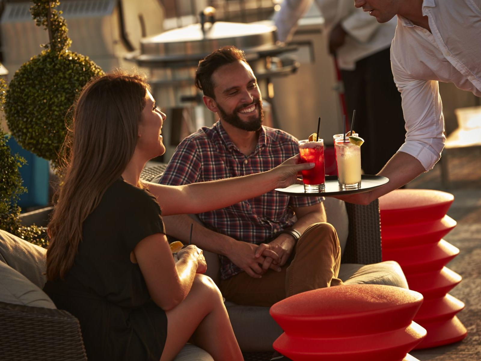 Guests enjoying drinks at rooftop patio