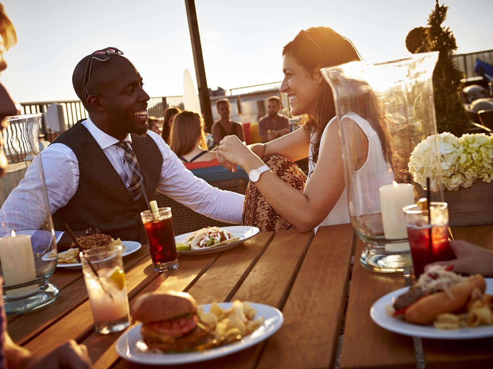 Guests enjoying a meal on the rooftop patio