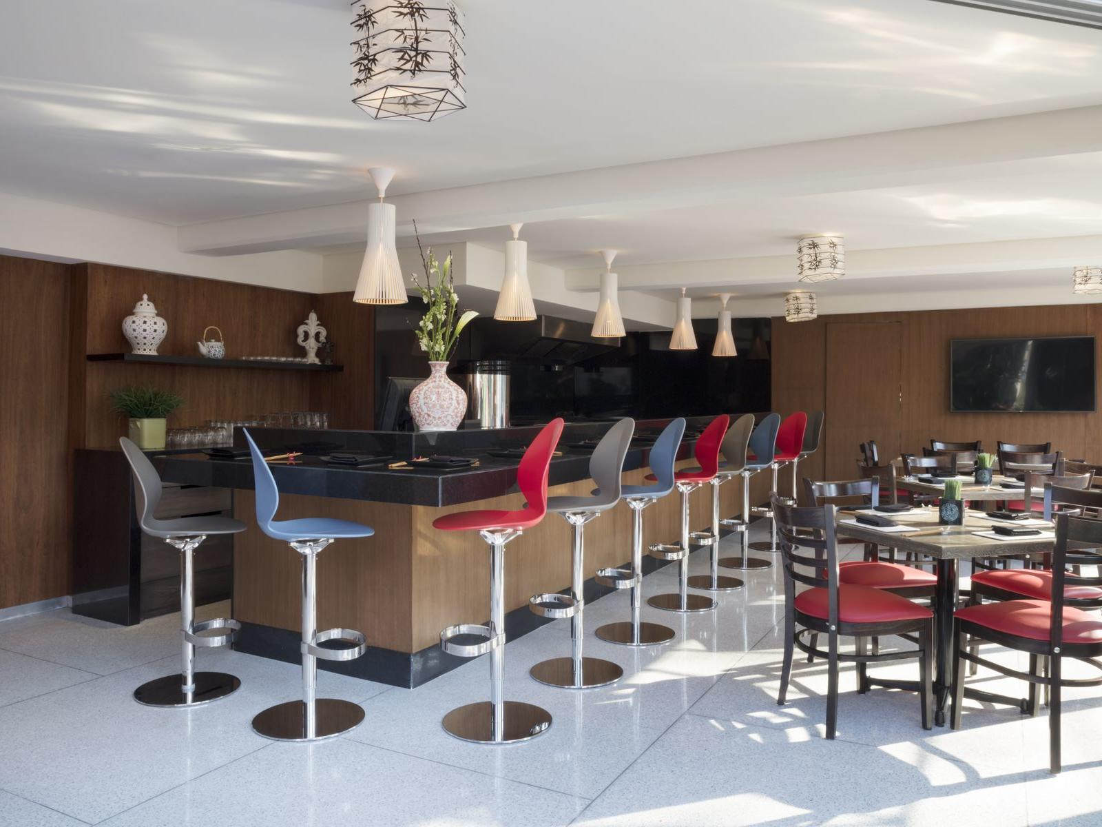 bar area with stools and tables