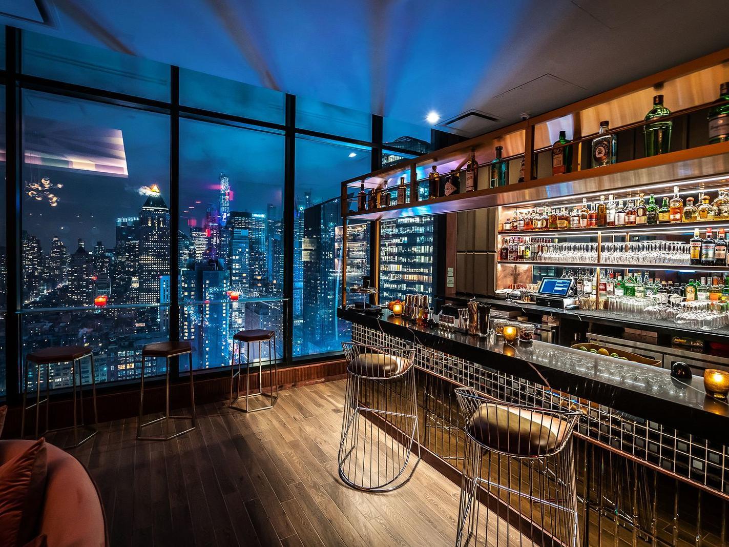Bar with Manhattan skyline view.