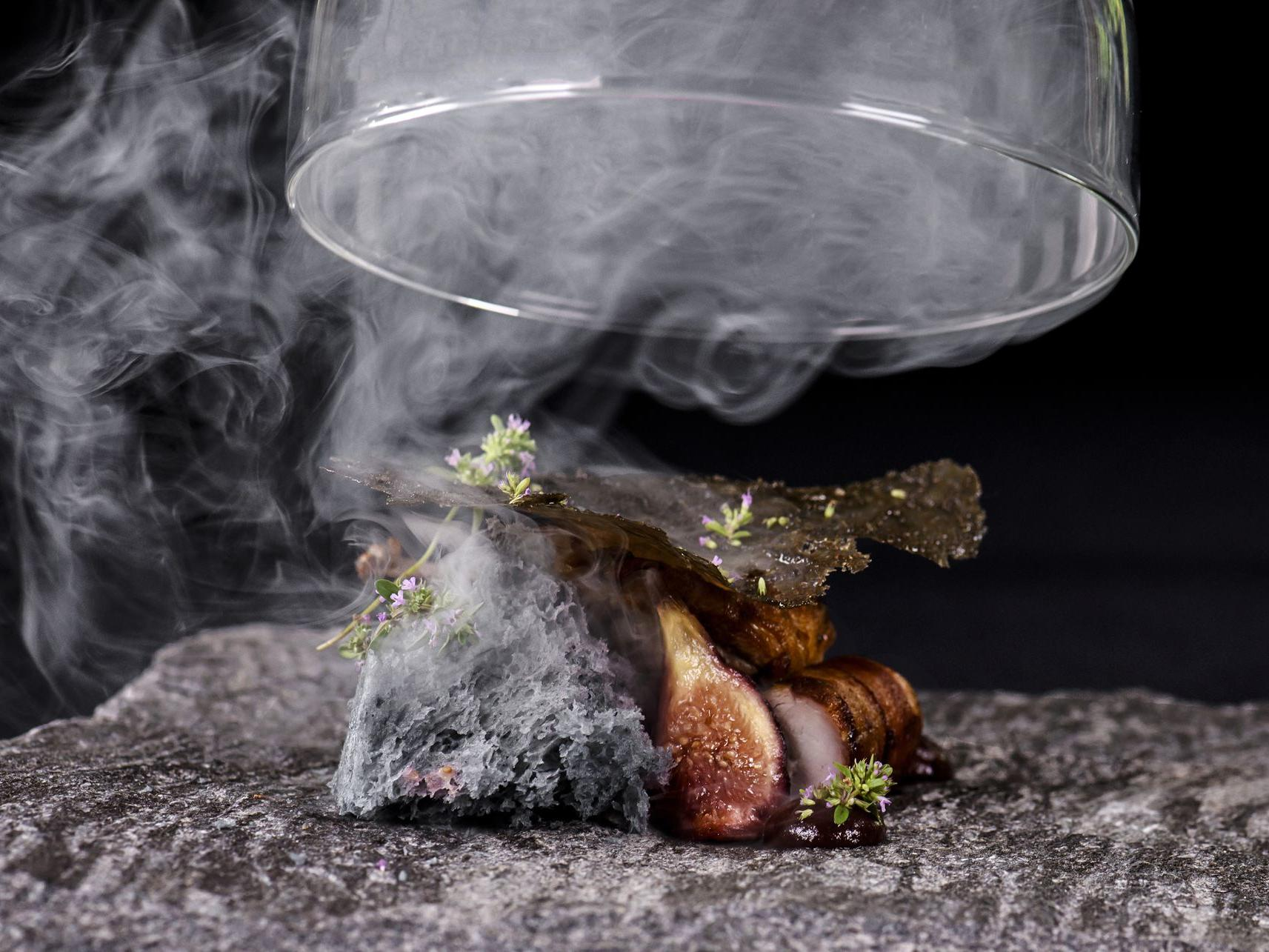 quail dish with smoke
