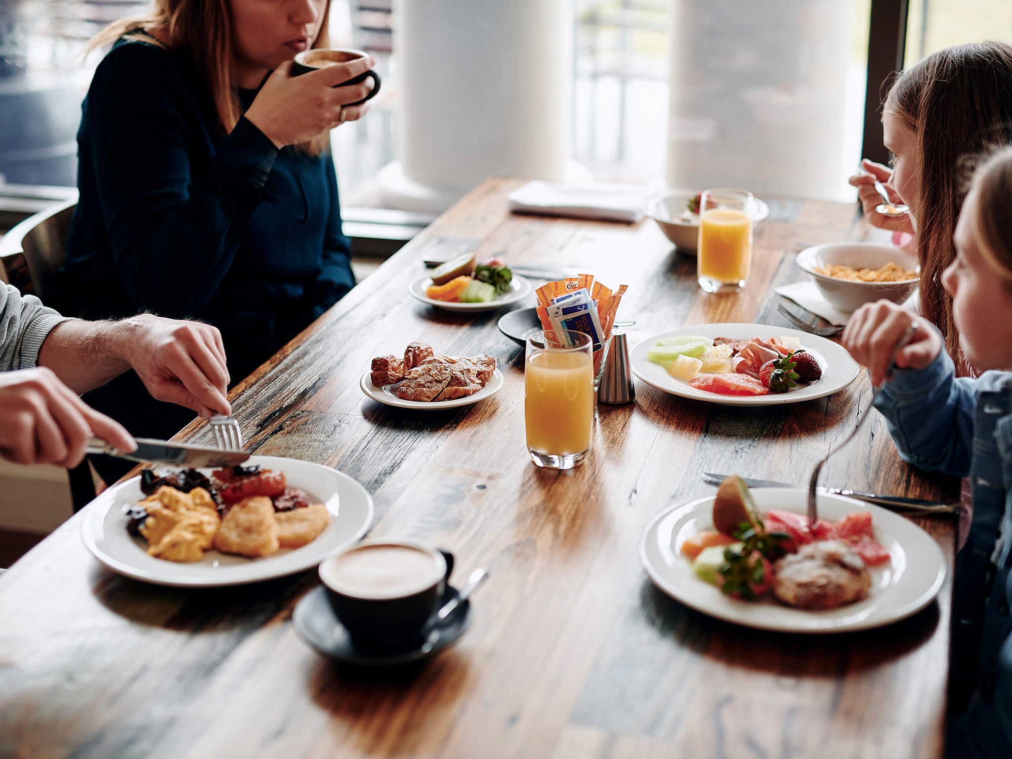 Family enjoying buffet breakfast at Bella Restaurant