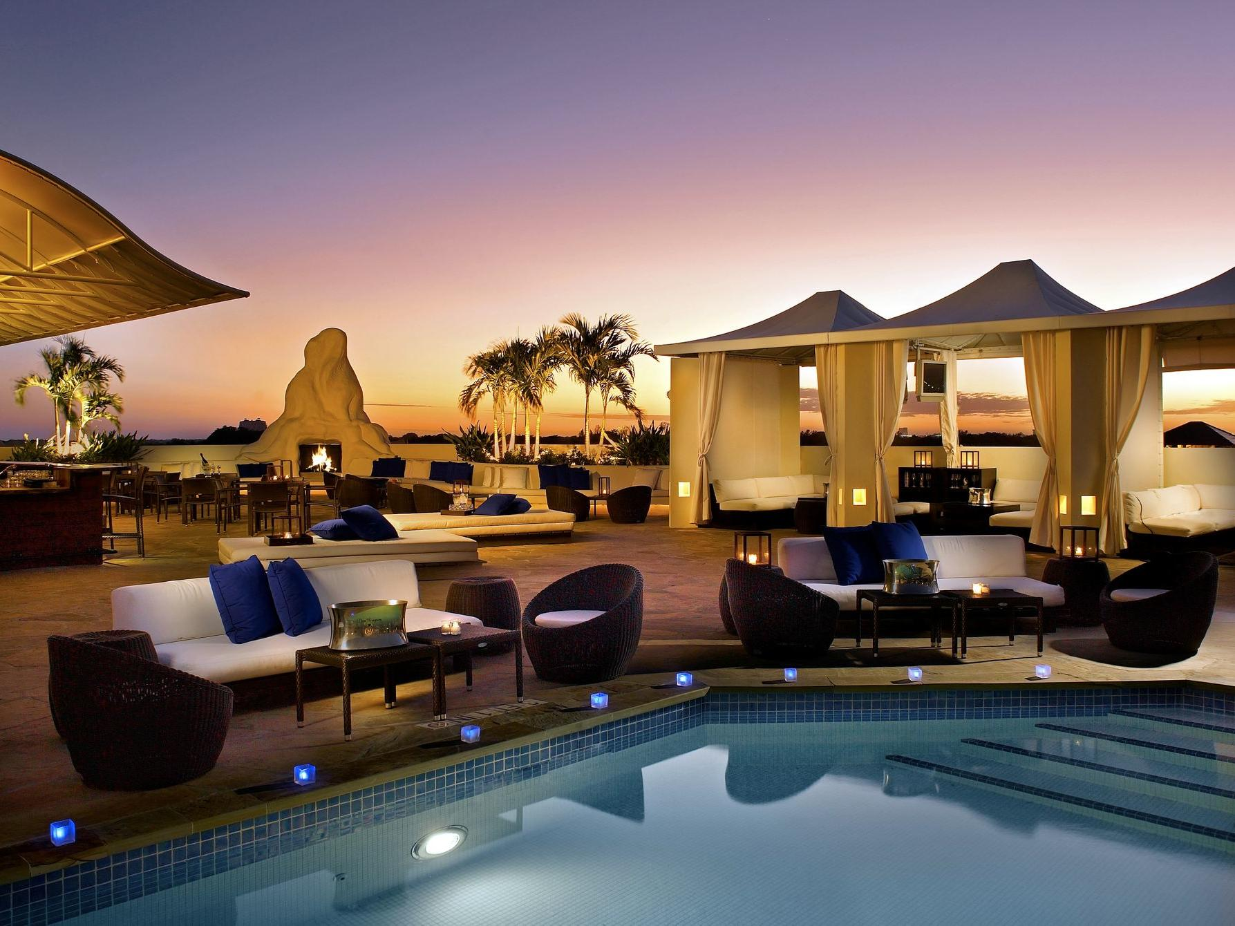 rooftop pool and lounge at night