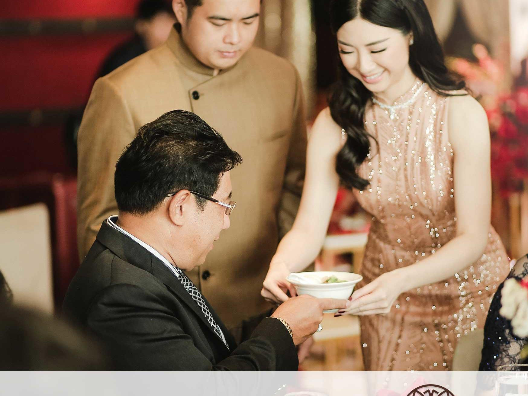 Couple holding tea ceremony at Xiang Fu Hai