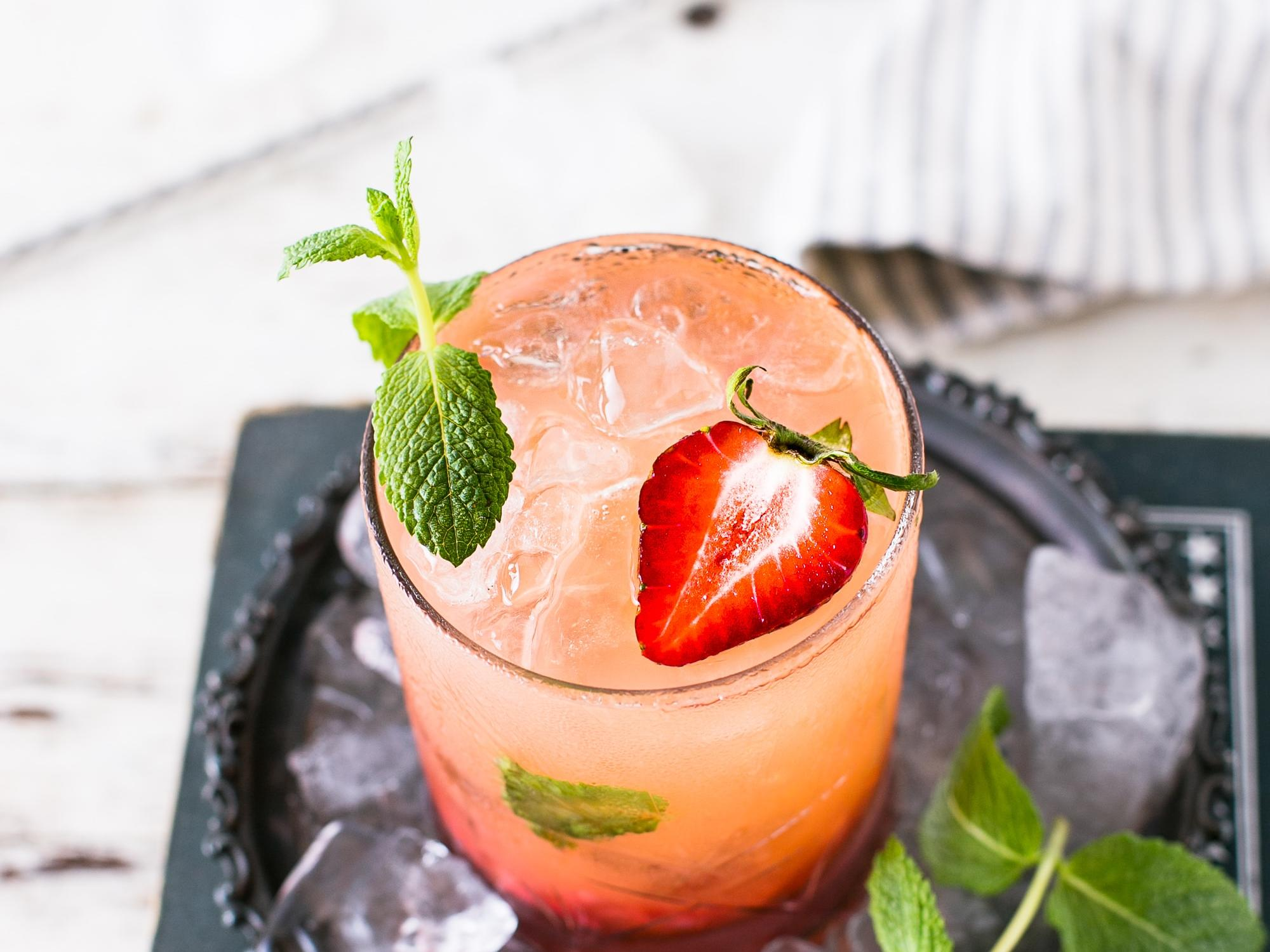 strawberry cocktail in clear glass with mint