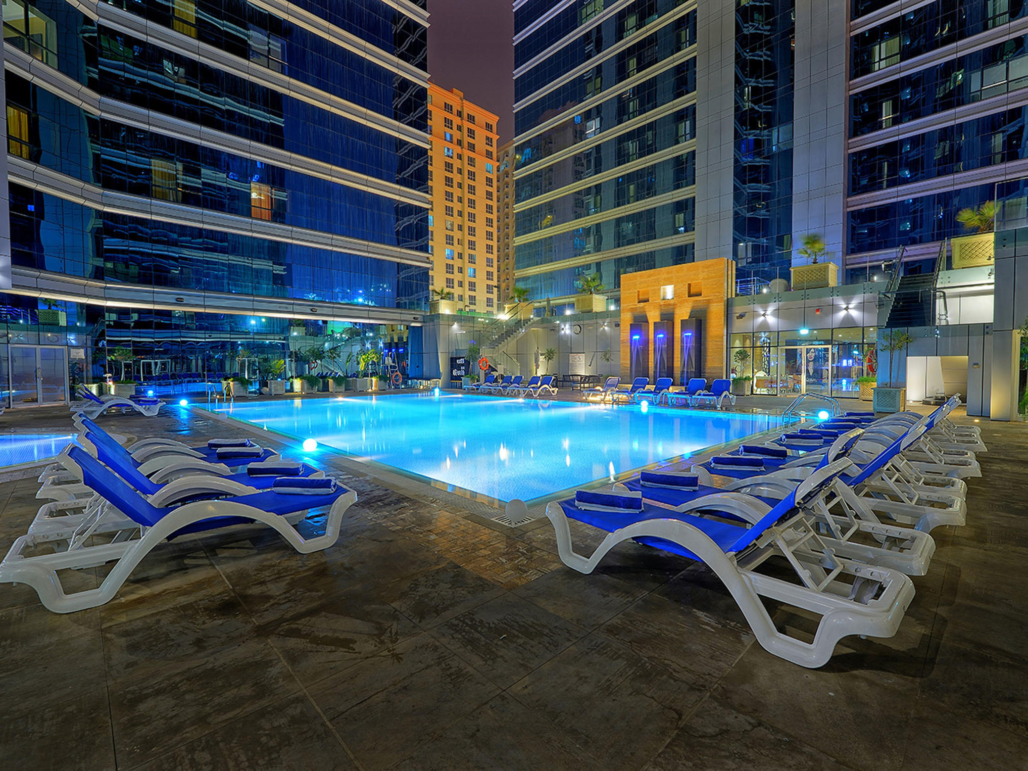 Pool by night at Ghaya Grand Hotel Dubai