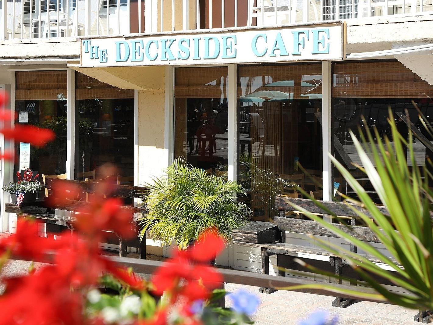 View looking at Deckside Cafe sign on front of building