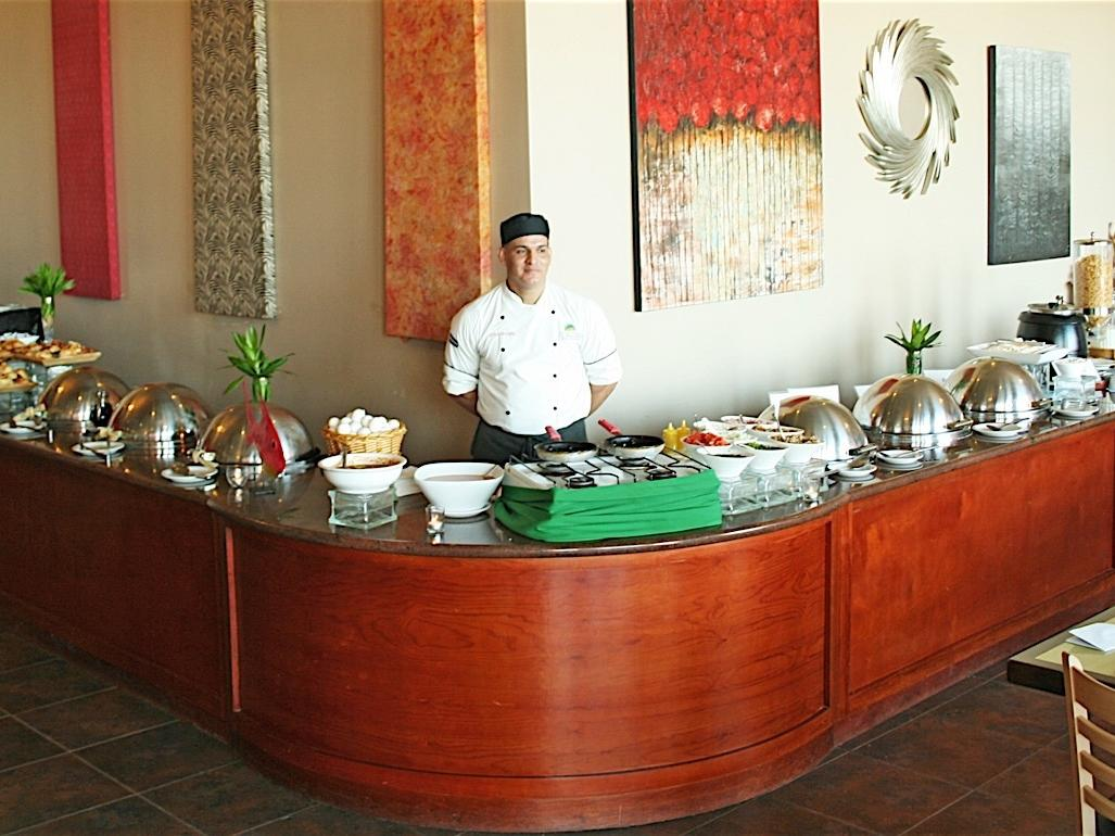 chef with buffet of food