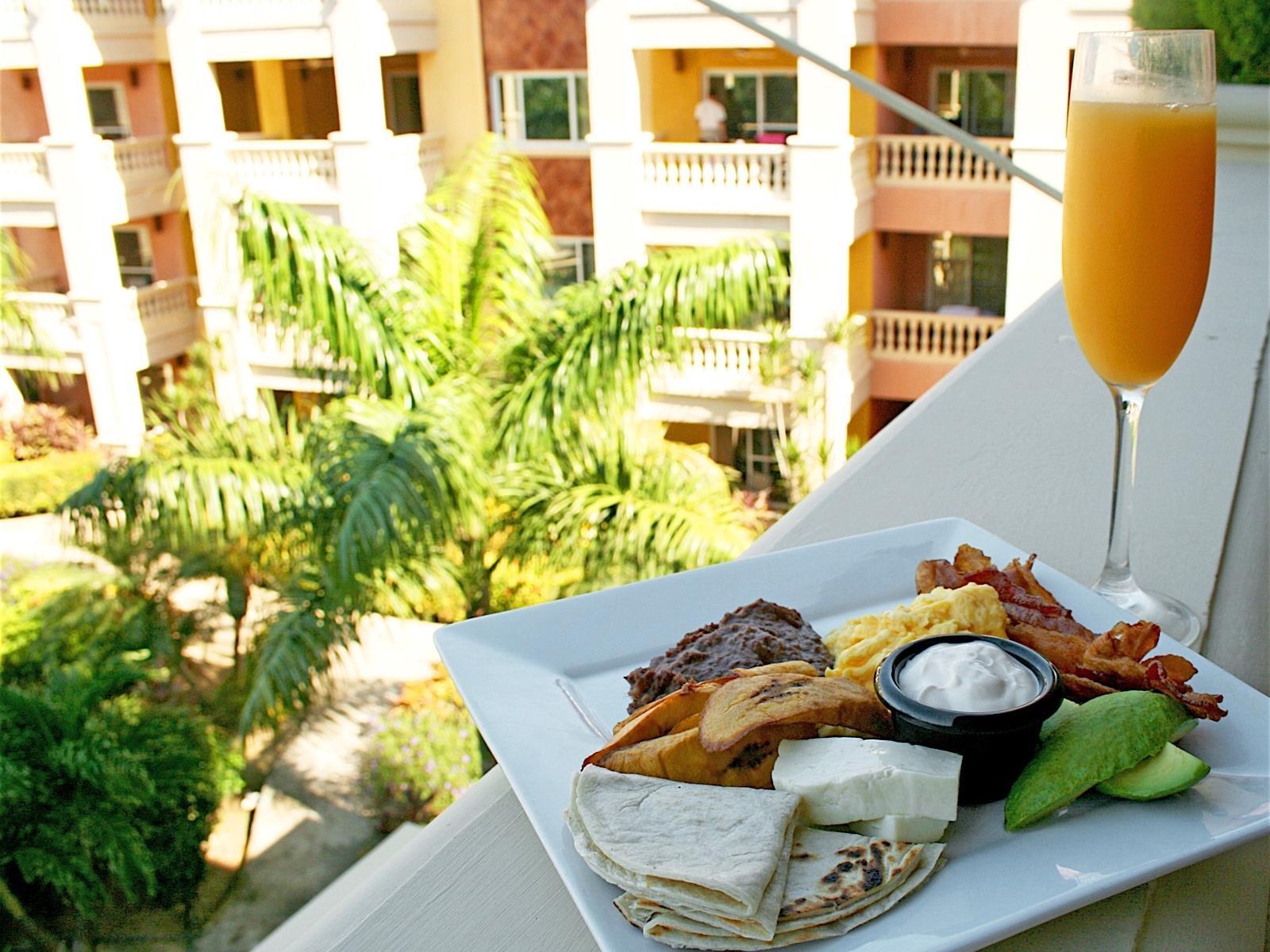 plate of food on ledge of balcony