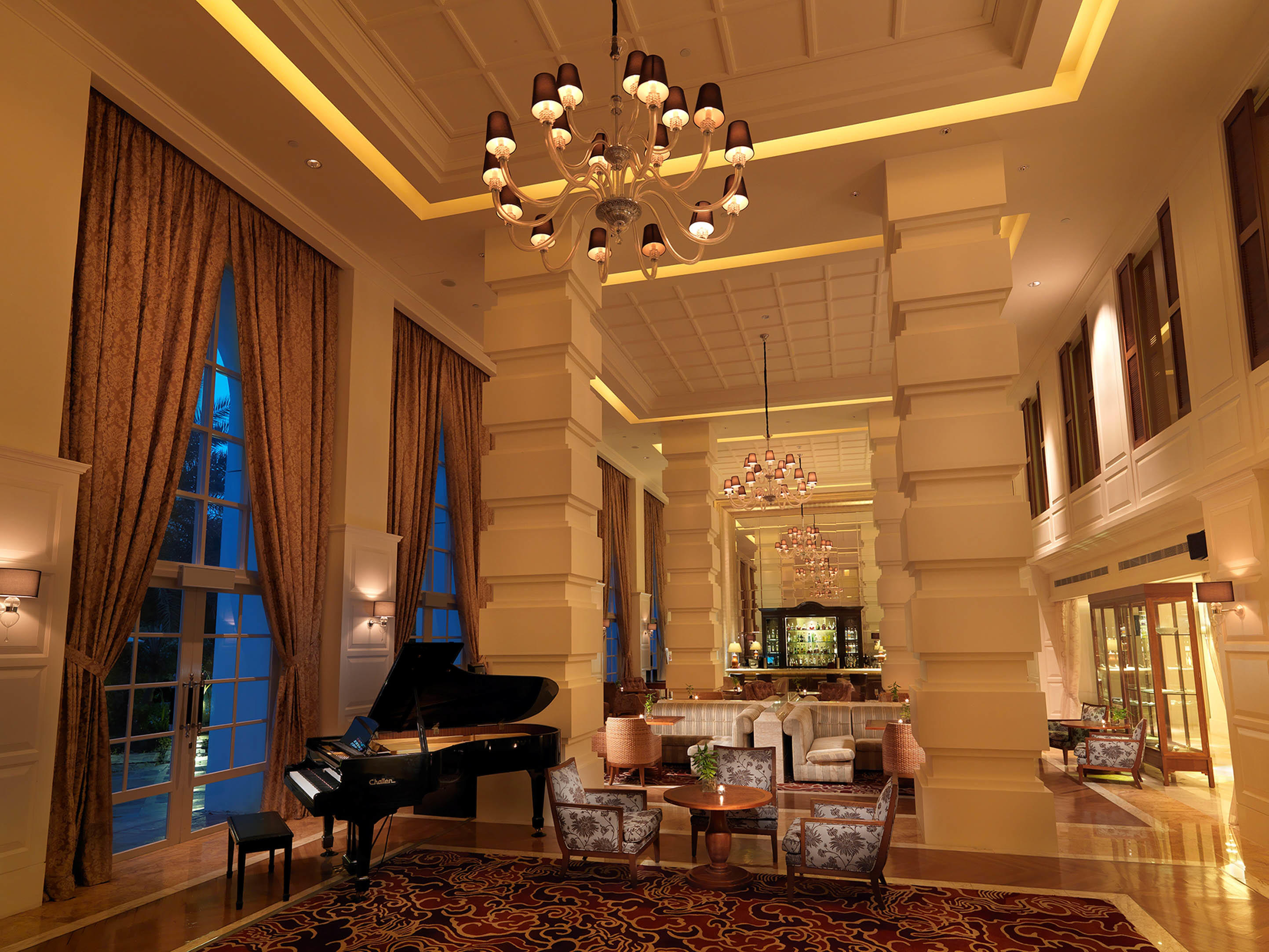 Interior of Verandah lounge, furnished with chandeliers, piano and couches