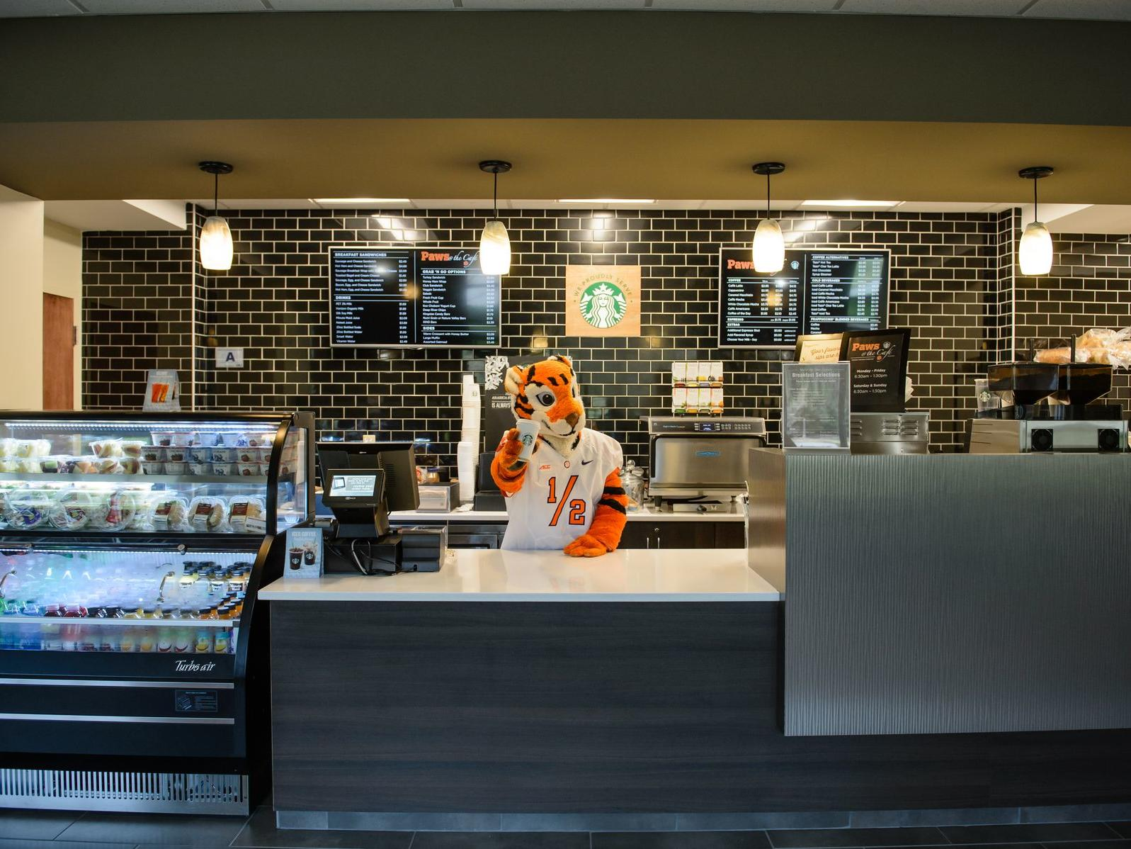 tiger mascot at cafeteria register