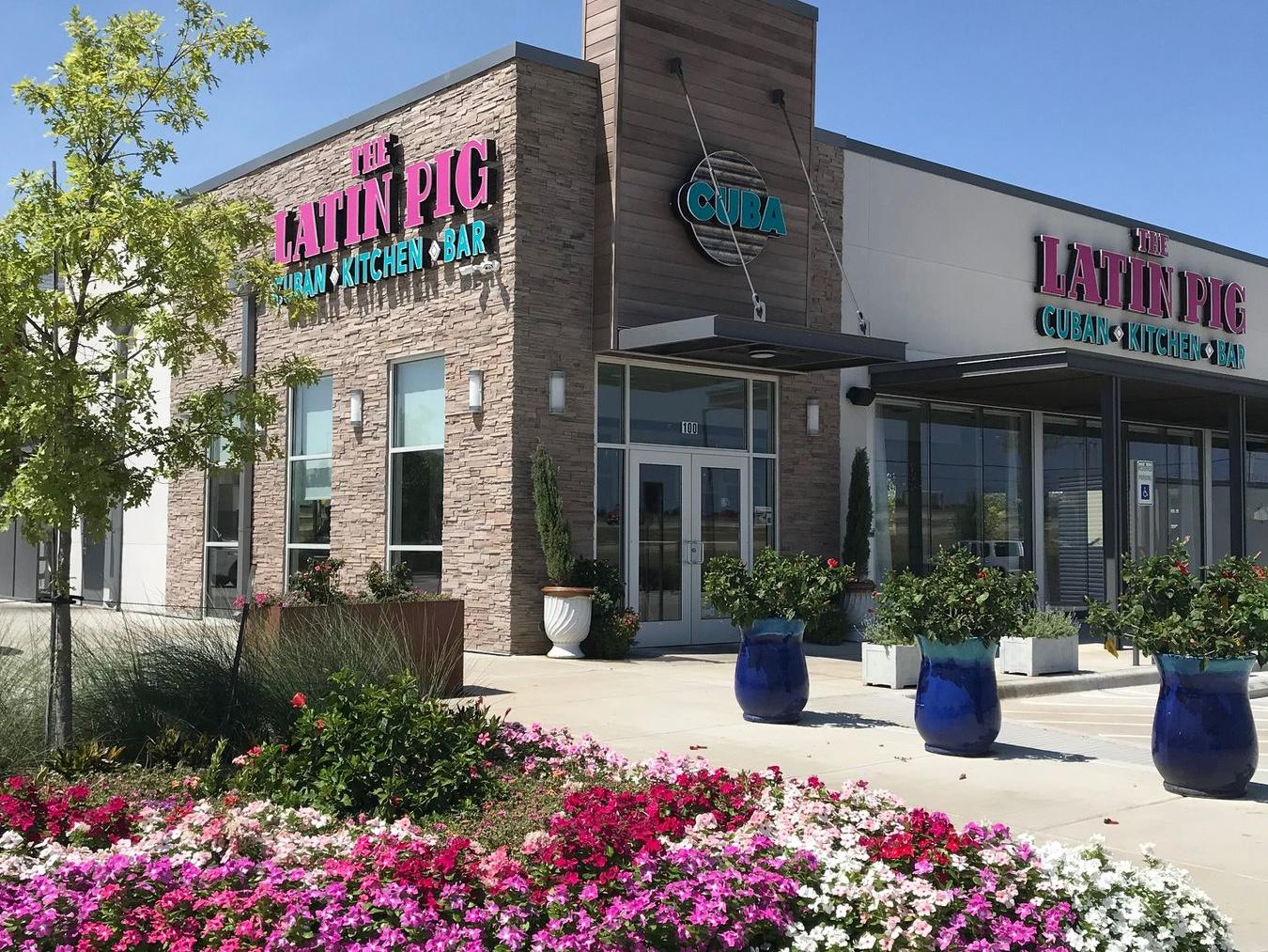 exterior of the latin pig with walkway and flowers