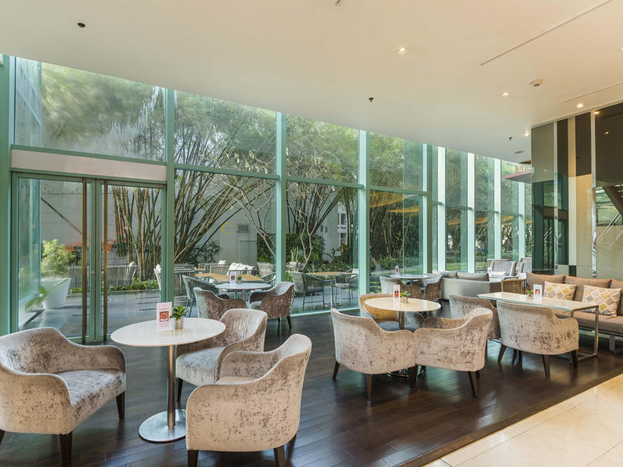 Elegant chairs in the dining area of the lobby lounge at Chatrium Hotel Riverside Bangkok