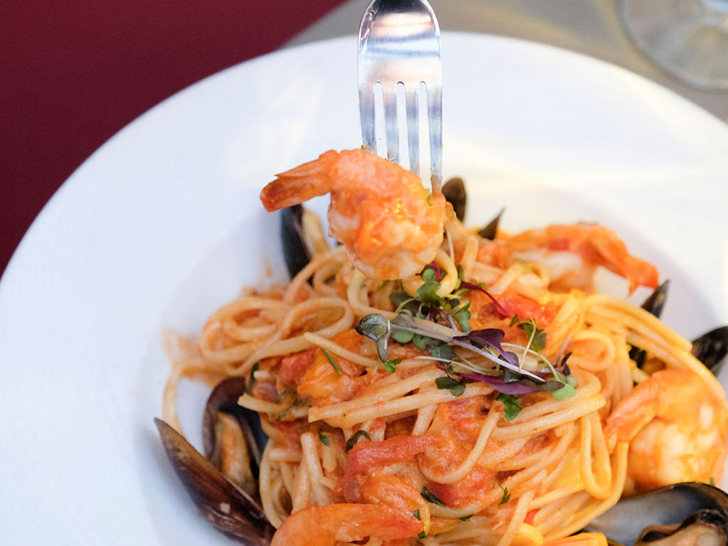bowl of seafood pasta with fork
