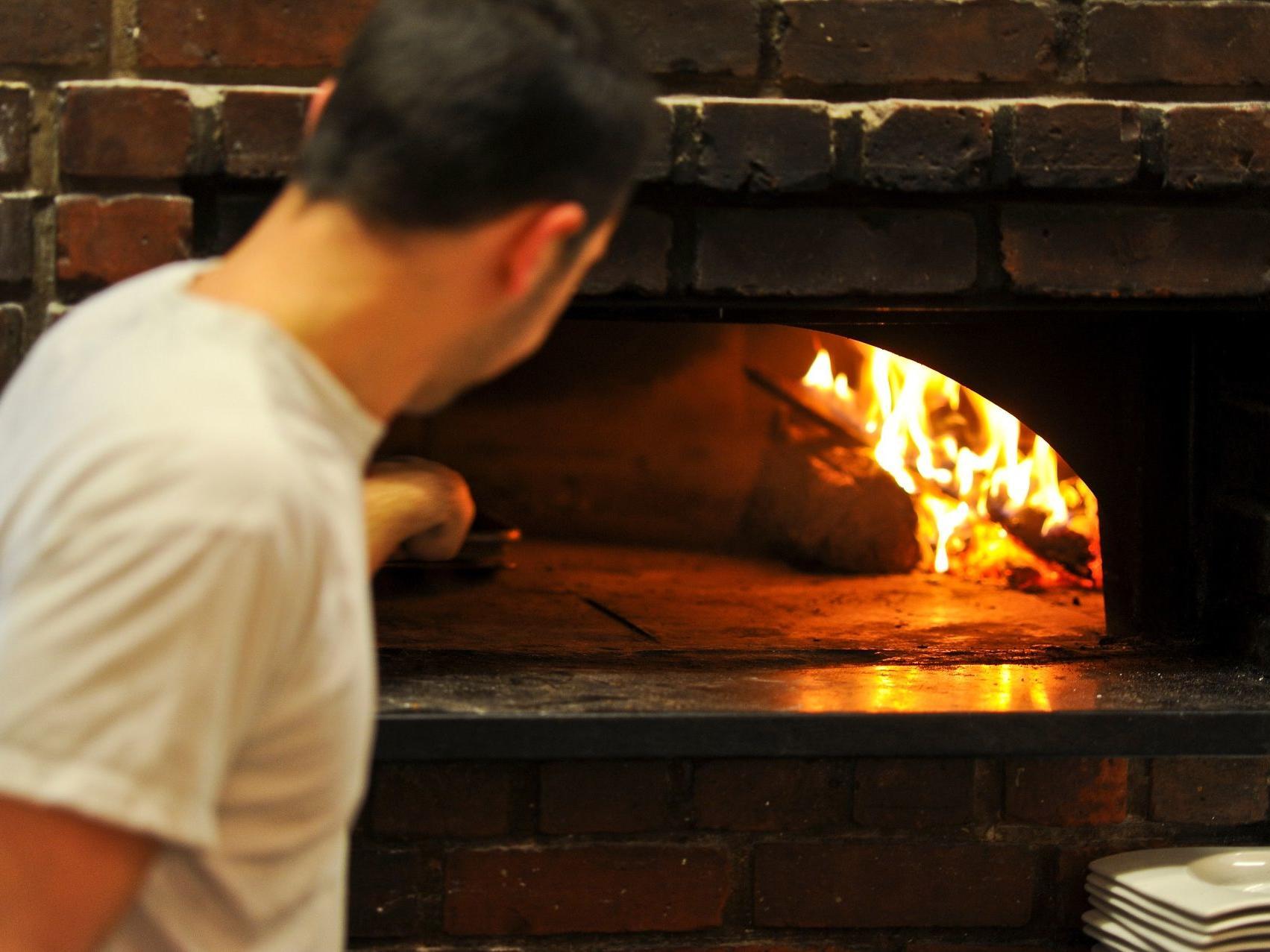 View of masonry oven in Piccolo Arancio at Farmington Inn and Suites