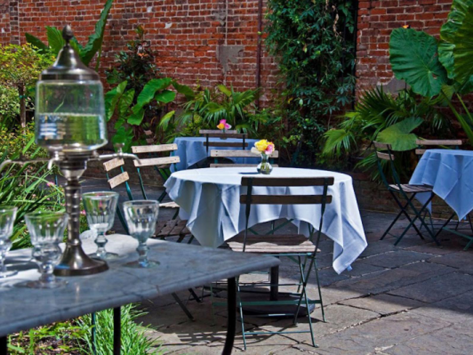 Outdoor dining area of Café Amelie near Andrew Jackson Hotel