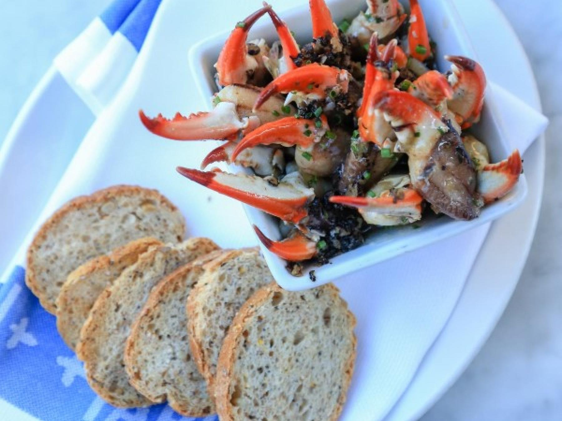 Crabs and bread served at Tableau near Andrew Jackson Hotel