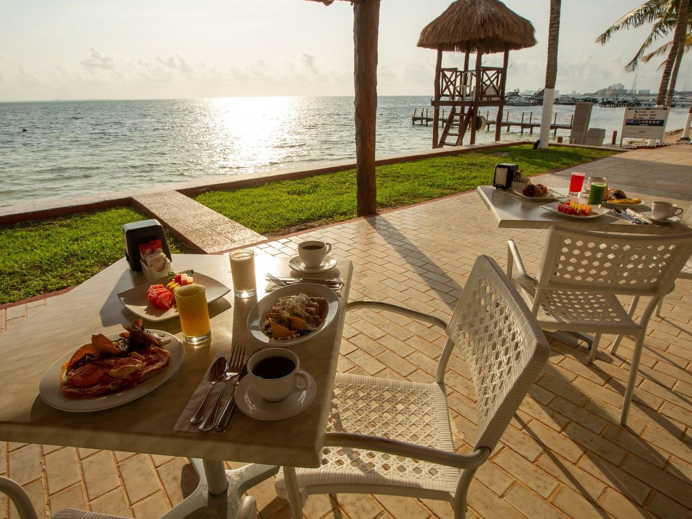 breakfast on two tables outside