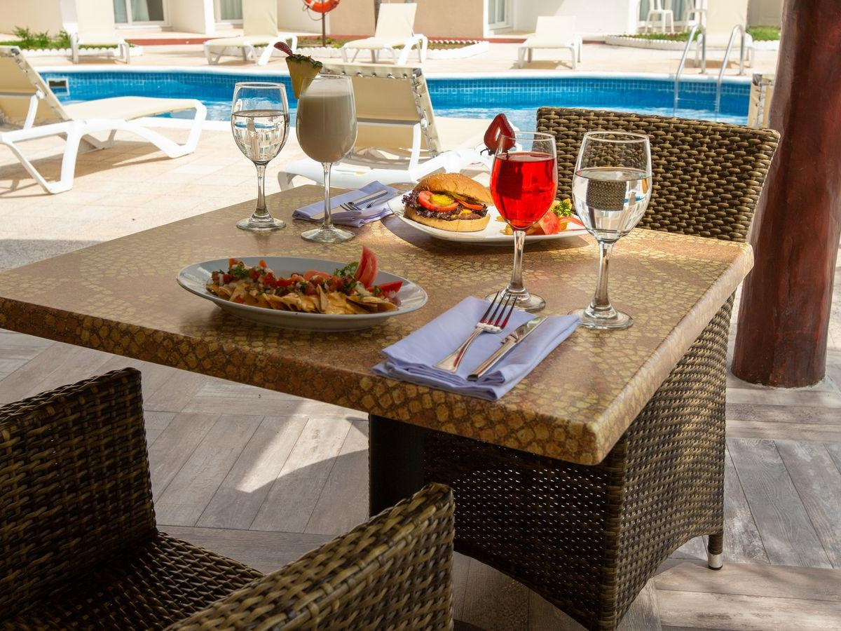 lunch on table next to a pool