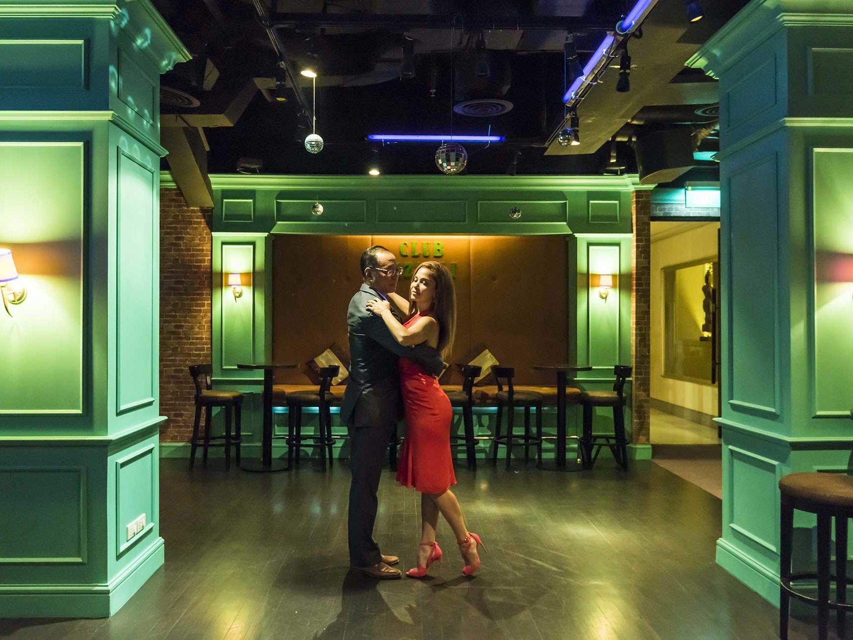 A couple dancing at Club Rizzoli at Chatrium Hotel Royal Lake