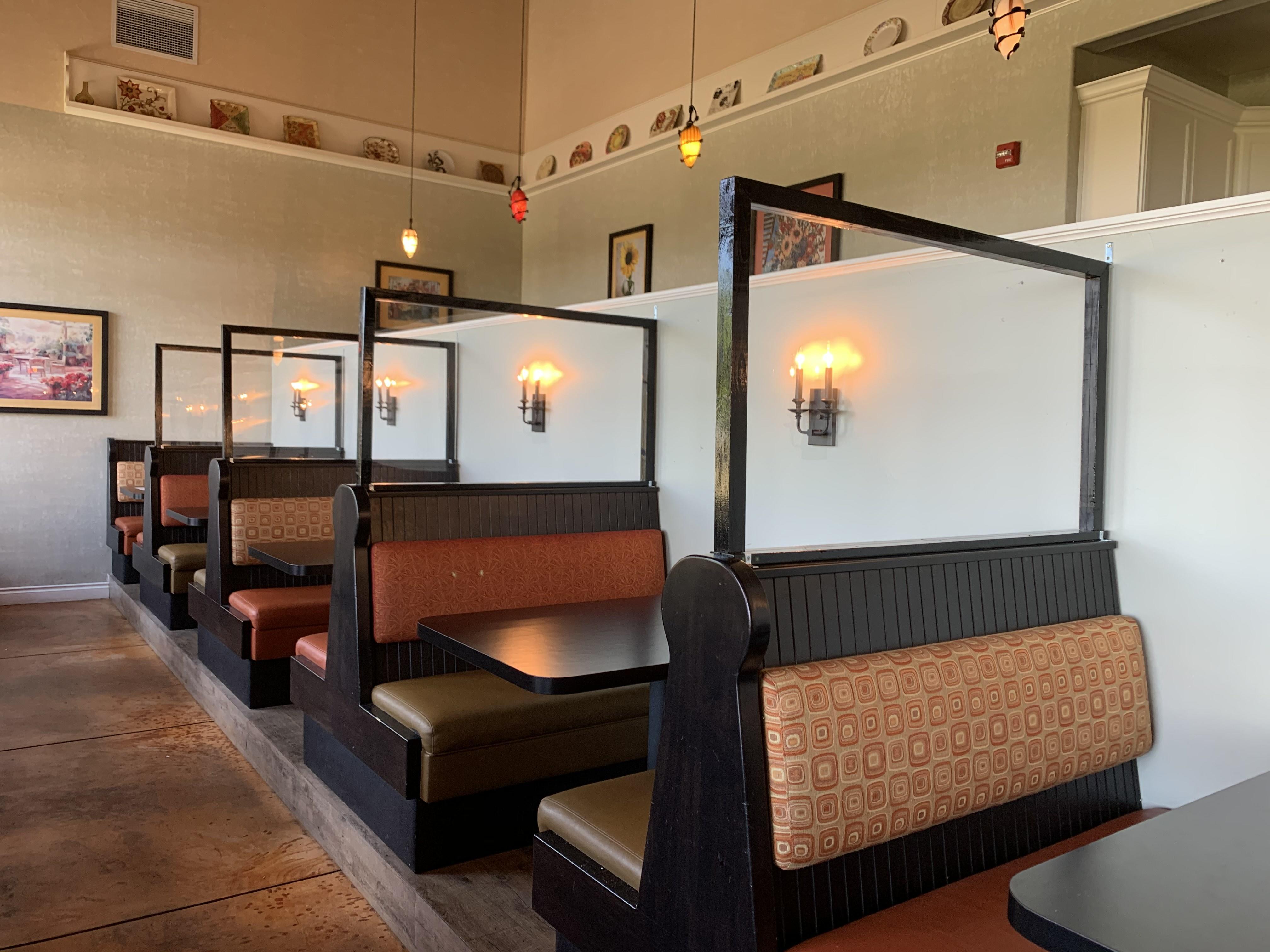 Plexiglass between restaurant booths