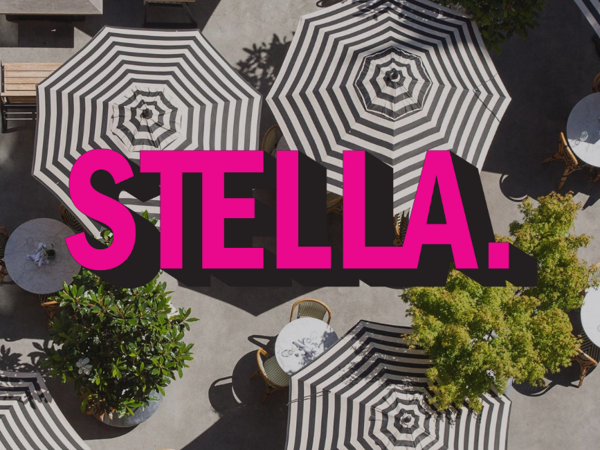 black and white umbrellas with pink lettering the word STELLA