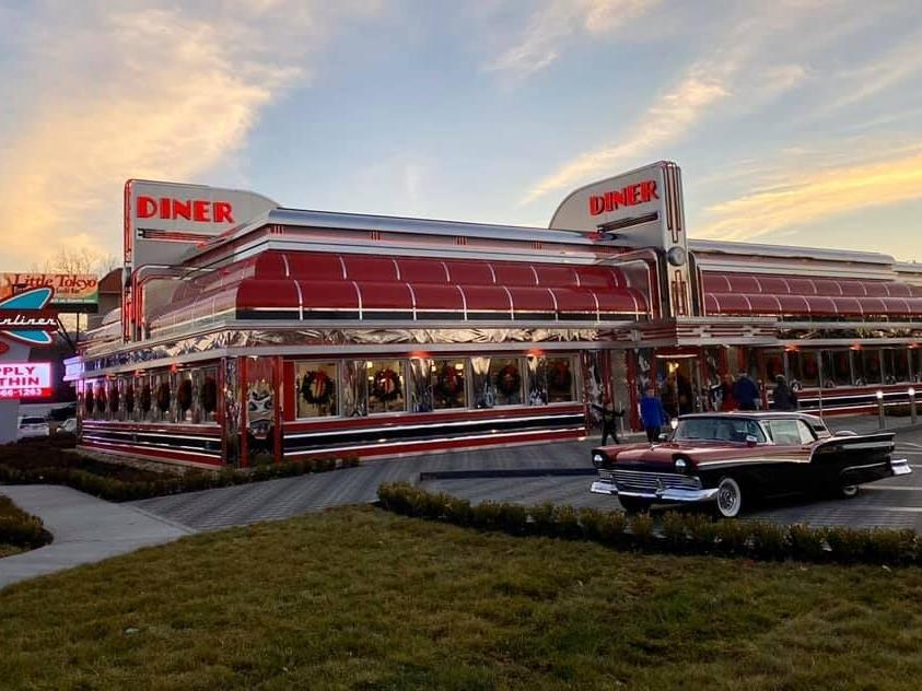 a car parked in front of a diner