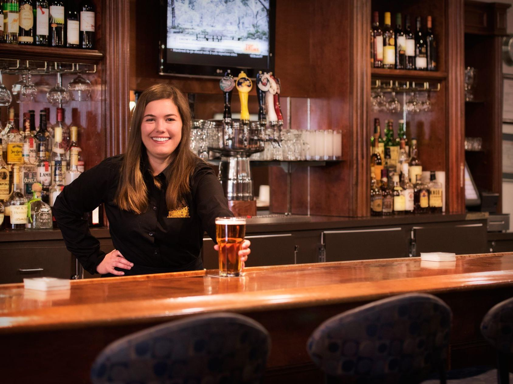 Bartender serving beer at Steele Street Lounge