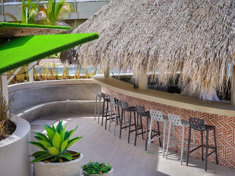 Relaxing pool and wet bar at Fiesta Resort