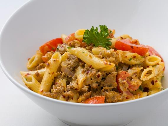 bowl of pasta with tomatoes and meat