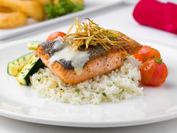 plate with salmon, rice and vegetables