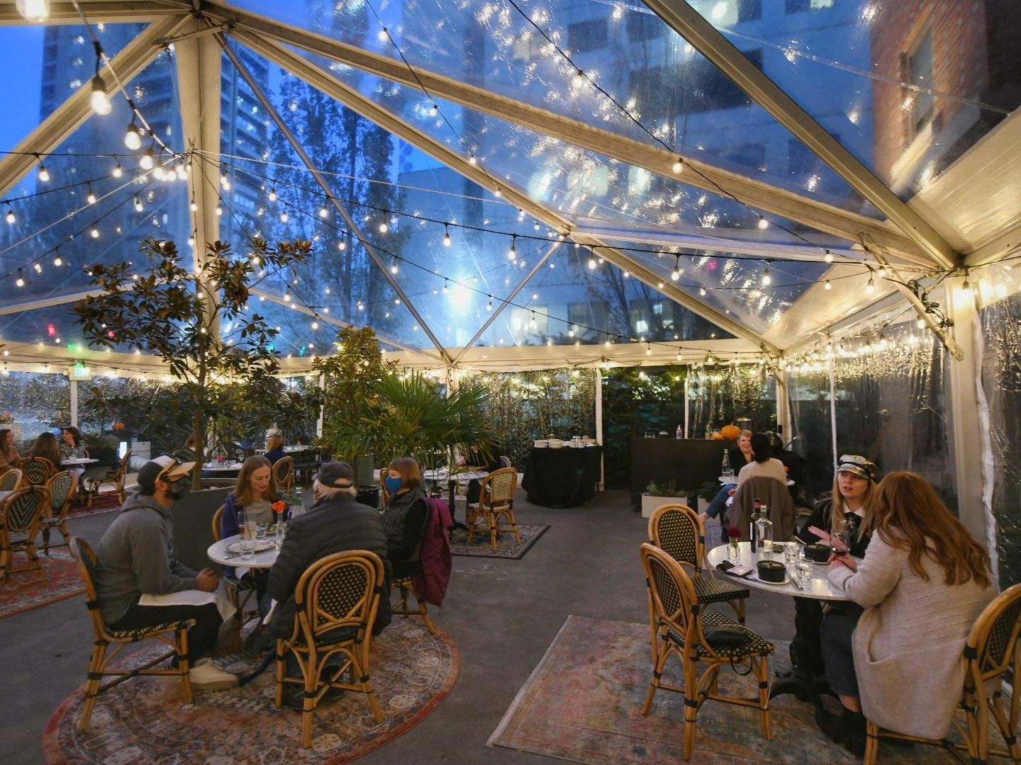 outdoor dining tent with twinkle lights