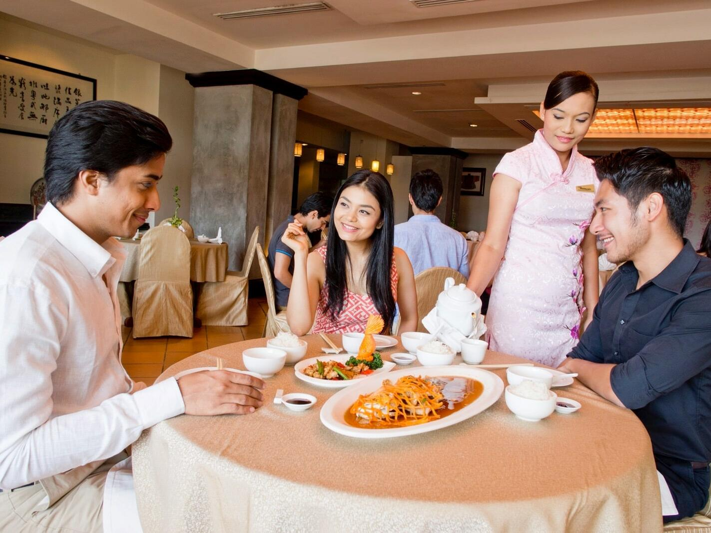 People enjoying food the Chinoise Restaurant